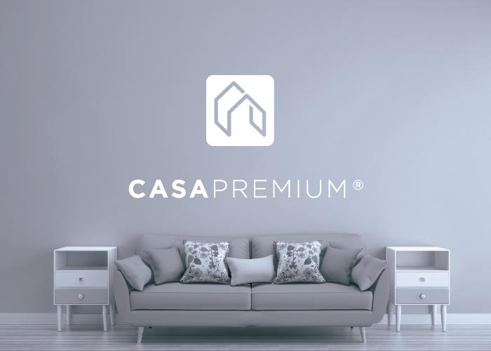 diseño logo inmobiliaria sofá